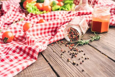 Vegetable ingredients for the healthy foods selection on tablecloth with natural herbs and pepper spice on wooden table Stockfoto