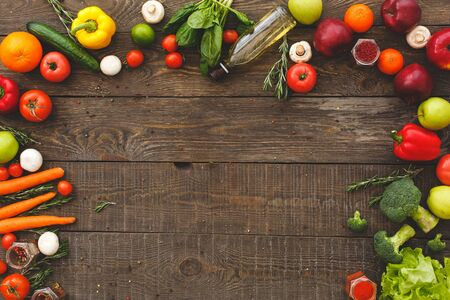 Vegan or diet food concept. Flat lay view of different vegetables with fresh ingredients for healthy cooking on rustic wooden table with copy space