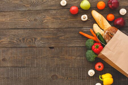 On the table lies bread and freshness vegetables. Wooden background top view mock-up Stockfoto