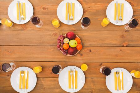Summer fruit and useful table. Festive table set for six people. Wooden background top view mock-up. Wooden background top view mock-up