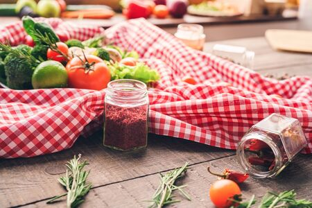 Many vegetables and spices are lying on the table before preparing salad Stockfoto
