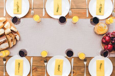 Laid table for lunch. Festive table set for six people. Wooden background top view mock-up