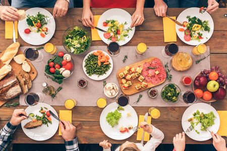 Every member of the family eats healthy food. Festive table set for six people. Wooden background top view mock-up