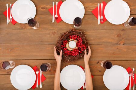 Red style. Table is set for a New Year's, christmas party. Festive table set for six people. Wooden background top view mock-up. Wooden background top view mock-up