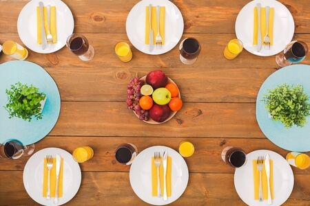 Spring or summer fruit and useful table. Festive table set for six people. Wooden background top view mock-up. Wooden background top view mock-up