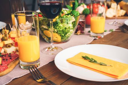 Empty plate and festive table. Many yellow color Standard-Bild