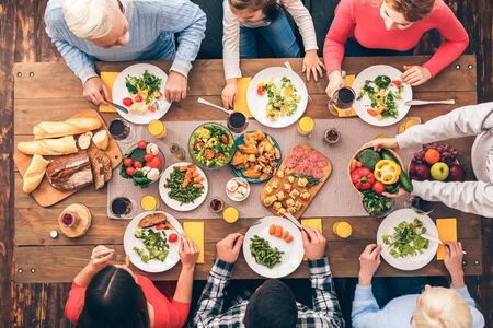 Healthy lifestyle. The family eats properly. Festive table set for six people. Wooden background top view mock-up. Wooden background top view mock-up Archivio Fotografico