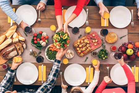 Colorful picture. Big family starts lunch or dinner. Festive table set for six people. Wooden background top view mock-up