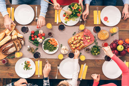Big great family start lunch or dinner Stock Photo