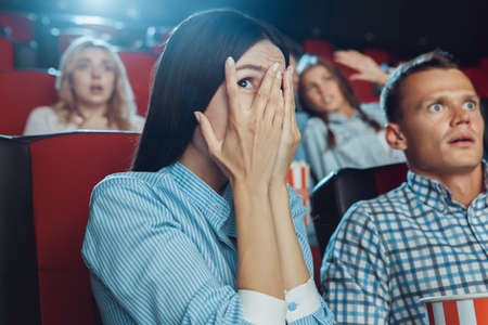 Young people friends together in the cinema