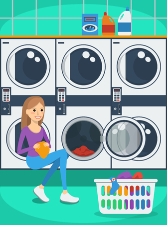 dirty girl: Portrait of woman with basket of clothes in laundromat