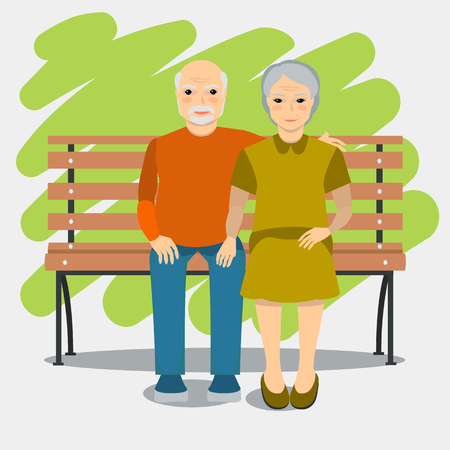 grandparents: Senior couple in love. Elderly people sitting on bench together. Grandparents or an lovely elderly couple sitting on a bench smiling.