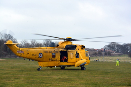 coastguard: RAF Search and Rescue Helicopter BRIDLINGTON EAST YORKSHIRE ENGLAND 15 MARCH 2015 Royal Air Force Sea King helicopter attending its final Search and Rescue training exercise with the Coastguard team at Bridlington in March 2015 Editorial