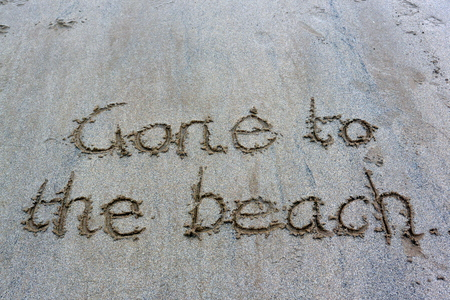 gone: Gone to the beach written in the sand