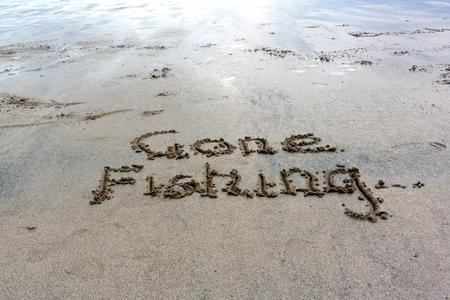 sand writing: Gone Fishing in sand writing