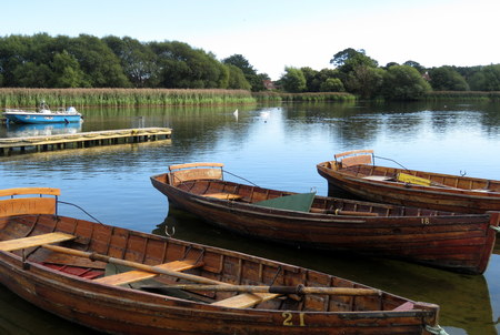 mere: Rowing boats at a small jetty on the mere at Hornsea, East Yorkshire, UK