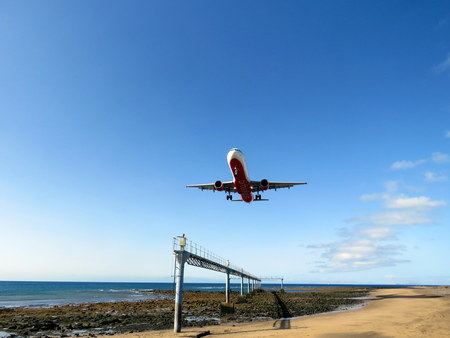 undercarriage: A Plane landing in Lanzarote PUERTA DEL CARMEN LANZAROTE 1ST SEPTEMBER 2015 An aeroplane landing at the airport during the busy summer season in Lanzarote September 1st 2015