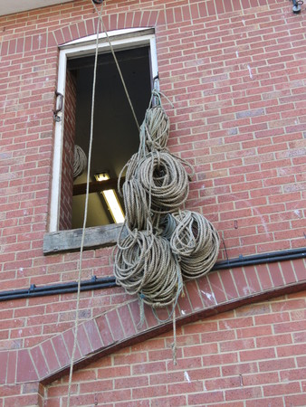 coils: Coils of ropes hanging from a window at the harbour in Scarborough North Yorkshire, England