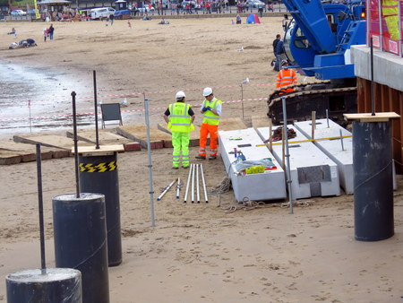 Construction Work on Scarborough Beach SCARBOROUGH, NORTH YORKSHIRE, ENGLAND 25 JULY 2015 Construction work taking place on Scarborough beach for the new lifeboat station and ramp on 25th July 2015
