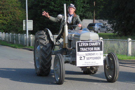 convoy: Charity Tractor Run LEVEN, EAST YORKSHIRE, ENGLAND 27 SEPTEMBER 2015 Tractors travelling in convoy to raise funds for charity, approaching the village of Leven, East Yorkshire on 27th September 2015