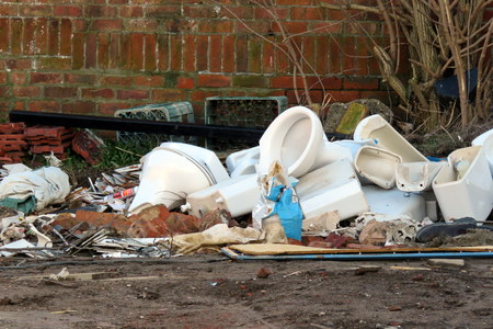 basins: Sinks, basins, cisterns, toilets piled outside on a building site
