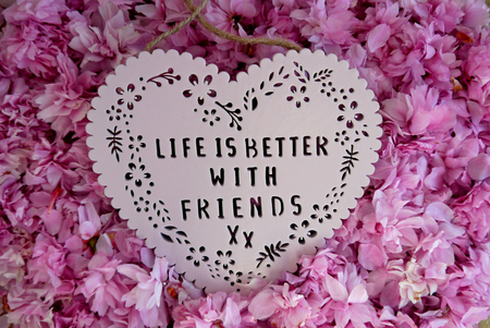 plaque: Life is better with friends heart shaped plaque on a pile of blossom