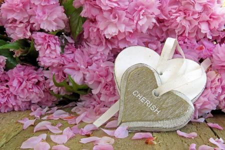 cherish: Heart shape engraved with cherish on a blossom background