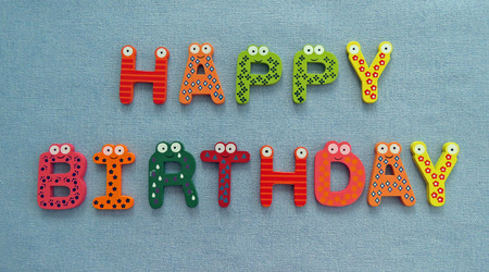 Colourful and patterned letters spelling out the phrase 'Happy Birthday' on a blue background