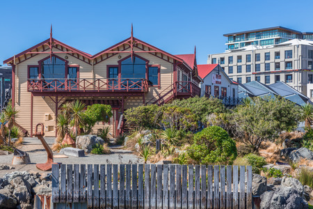 sheds: Wellington, New Zealand, February 11 2016 - Wellington waterfront lagoon, historic boat sheds (Star Boating Club 1885 and Wellington Rowing Club 1894) Editorial
