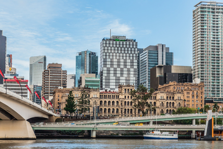 Brisbane, Australia, March 11 2016: Treasury Building, Brisbane, seen from the river, surrounded by high-rise buildings. Redakční