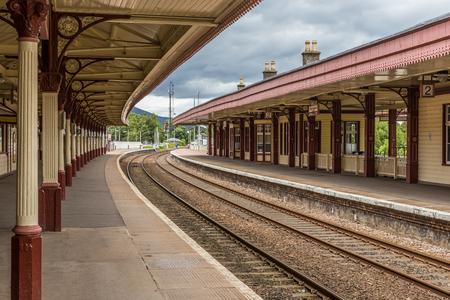 Aviemore, Scotland, UK, June 30, 2016: Railway lines passing through the Victorian railway station in Aviemore, Scotland. Editöryel