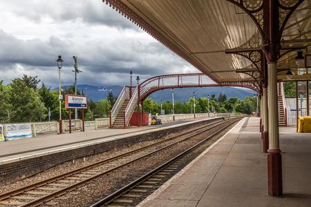 Aviemore, Scotland, UK, June 30, 2016: Railway lines and passenger footbridge in Aviemore Station.