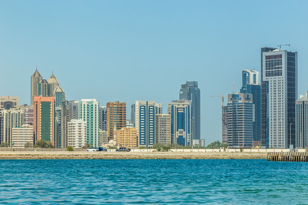 Abu Dhabi, United Arab Emirates, May 20, 2017: The view from the sea of the buildings and skyscrapers in downtown Abu Dhabi. Editöryel