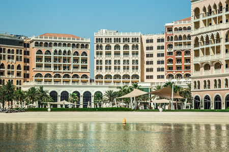 Abu Dhabi, United Arab Emirates, June 10, 2017: The Ritz-Carlton Hotel, Abu Dhabi, as seen from the water, with reflections.