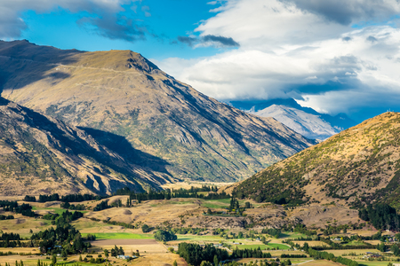 View from Crown Range Lookout in South Island, New Zealand, showing an aerial view of a valley among the mountains. Stok Fotoğraf