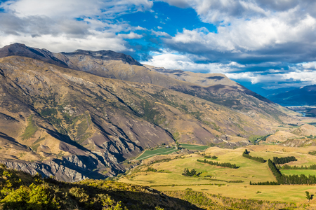 View from Crown Range Lookout over a valley surrounded with mountains in South Island, New Zealand. Stok Fotoğraf