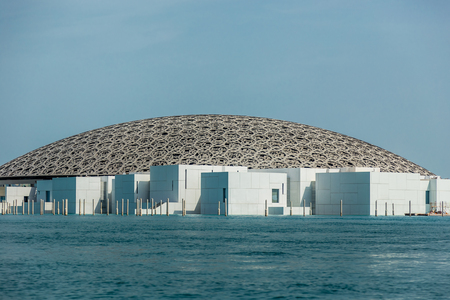 Abu Dhabi, UAE, April 27, 2018: View of the Louvre, Abu Dhabi, as seen from the from the sea,showing some of the rooms that hold the art galleries.