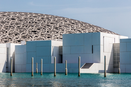 Abu Dhabi, UAE, April 27, 2018: Close up of the Louvre, Abu Dhabi, as seen from the from the sea, showing some of the extended art galleries. Editöryel