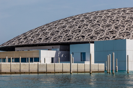 Abu Dhabi, UAE, April 27, 2018: Close up of the Louvre, Abu Dhabi, as seen from the from the sea, showing the protective wall.