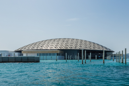 Abu Dhabi, UAE, April 27, 2018: View of the Louvre, Abu Dhabi, as seen from the from the sea.