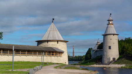Pskov. Russia. Pskov Kremlin. The bell tower of the Trinity Cathedral. Towers of Pskov Krom and the Roundabout city at the mouth of the Pskov river. Russian fortress. Ploskaya and Vysokaya towers