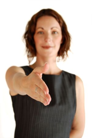 thirtys: Business woman with outstretched hand - focus on hand Stock Photo