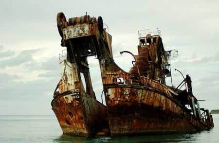 ship wreck: Colour shot of a ship wreck - formally a dredge.  Stock Photo