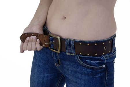 tight jeans: Already slim woman tries to tighten her belt. Stock Photo