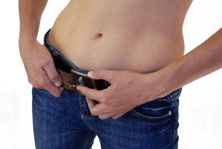 tighten: A colour shot of a woman tightening her belt Stock Photo