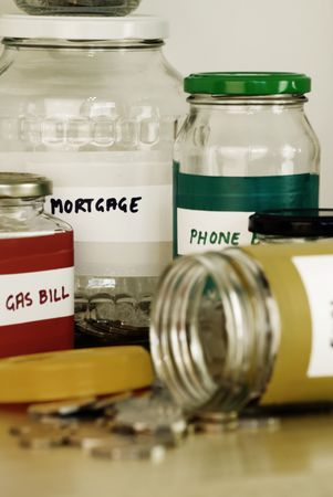 allocation: Labeled glass jars used for allocating the household spending.