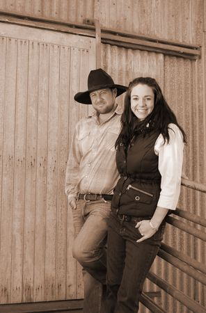 Sepia shot of a young country farming couple photo