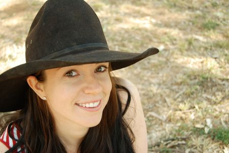 black cowgirl: Beautiful country woman in a cowgirl hat outdoors Stock Photo
