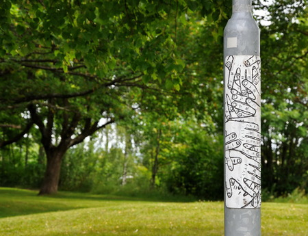 peace pipe: Grey pipe with a poster with the image of hands staying in the park