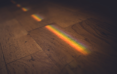 Close up photo of rainbow on wooden floor. Archivio Fotografico